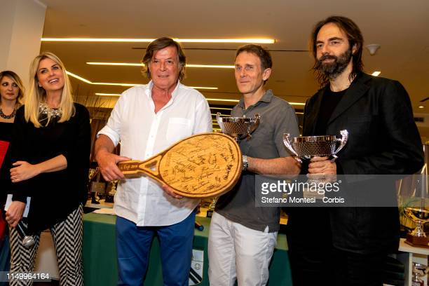 Adriano Panatta awards Neri Marcorè Stefano Meloccaro winners for the in the first edition of the Wellness cup at the Tennis Club Parioli on June 13...