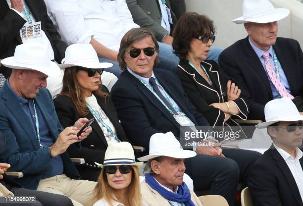 Adriano Panatta between his wife Rosaria Panatta and Virginia Ruzici attends the men's final during day 15 of the 2019 French Open at Roland Garros...
