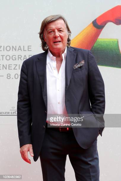 Adriano Panatta walks the red carpet ahead of the The Armadillo's Prophecy screening during the 75th Venice Film Festival at Sala Darsena on...