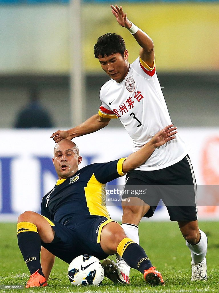 Adriano Pellegrino (L) of the Mariners challenges Zhang Chenglin of Guizhou Renhe during the AFC Champions League match between Guizhou Renhe and Central Coast Mariners at Olympic Sports Center on April 9, 2013 in Guiyang, China.
