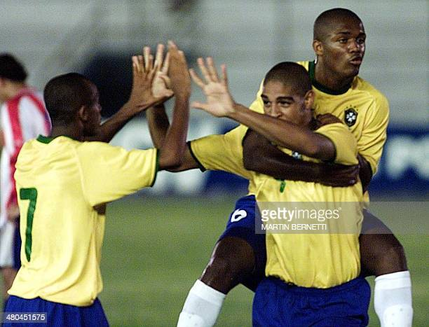 Adriano the Brazilian player celebrates his team's first goal against Paraguay with teammates Ewerton and Leiton Santos during a game counting...