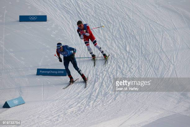 Adrien Backscheider of France and Johannes Hoesflot Klaebo of Norway compete during CrossCountry Skiing men's 4x10km relay on day nine of the...