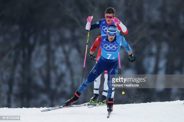 Adrien Backscheider of France and Johannes Hoesflot Klaebo of Norway compete in the final leg during CrossCountry Skiing men's 4x10km relay on day...
