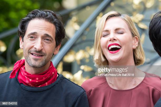 Adrien Brody and Charlize Theron attend the Thaddaeus Ropac's brunch during the amfAR EpicRide to Life Ball at Villa Emslieb on June 1 2018 in...