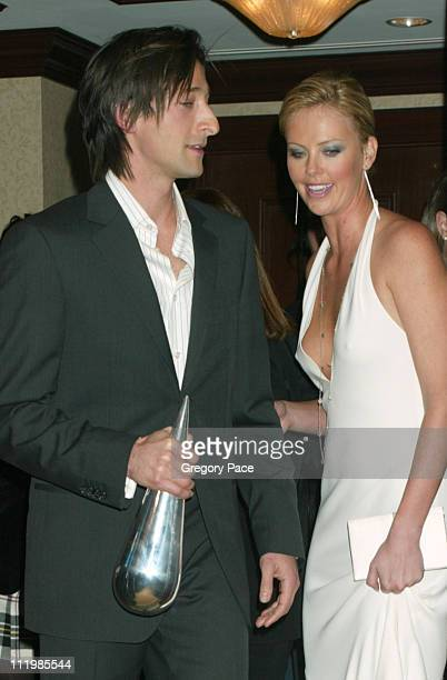 Adrien Brody and Charlize Theron during Spike TV Presents GQ Men of the Year Awards 2003 Press Room at The Regent Wall Street in New York City New...