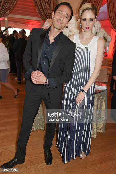 Adrien Brody and Coco Rocha attend The 9th Annual Filmmakers Dinner hosted by Charles Finch and JaegerLeCoultre at Hotel du CapEdenRoc on May 19 2017...