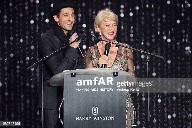 Adrien Brody and Helen Mirren appear on stage at the amfAR's 23rd Cinema Against AIDS Gala at Hotel du Cap-Eden-Roc on May 19, 2016 in Cap d'Antibes,...