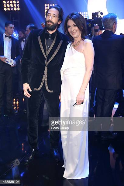 Adrien Brody and Iris Berben are seen on stage at the GQ Men Of The Year Award 2014 at Komische Oper on November 6 2014 in Berlin Germany