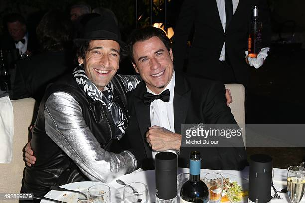 Adrien Brody and John Travolta attend the Puerto Azul Experience Inside Party at the 67th Annual Cannes Film Festival on May 21 2014 in Cannes France