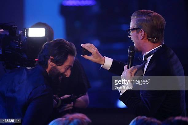 Adrien Brody and Joko Winterscheidt are seen at the GQ Men Of The Year Award 2014 at Komische Oper on November 6 2014 in Berlin Germany