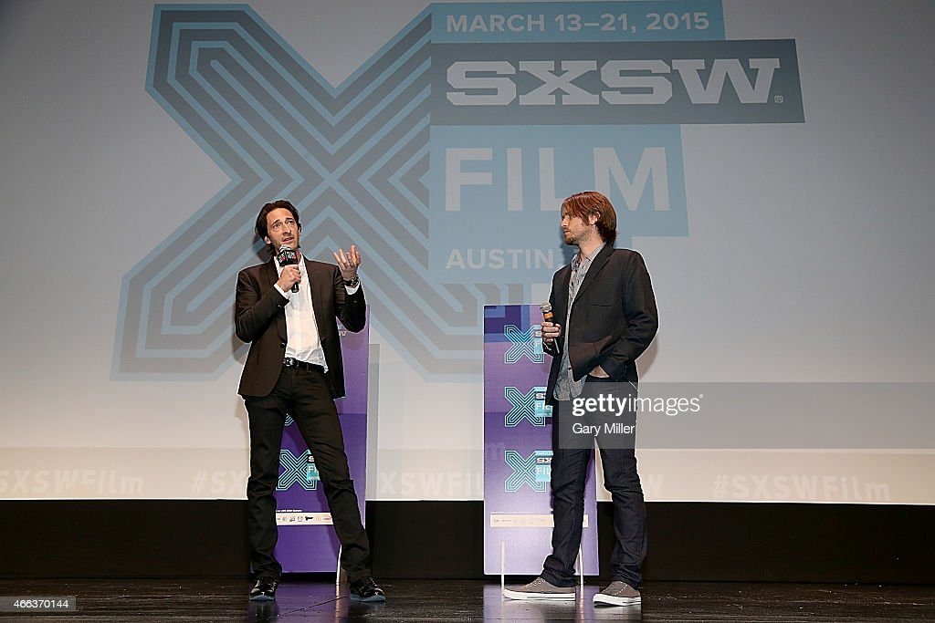 Adrien Brody (L) and Kevin Ford speak to the audience after a screening of 'Stone Barn Castle' at the Topfer Theater during the South by Southwest Film Festival on March 14, 2015 in Austin, Texas.