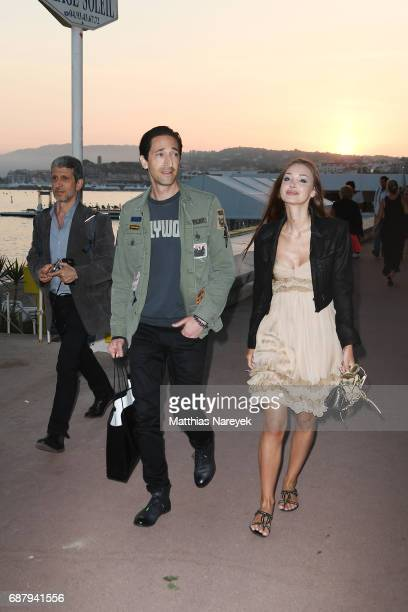 Adrien Brody and Lara Lieto are seen walking by the sea during the 70th annual Cannes Film Festival on May 24 2017 in Cannes France