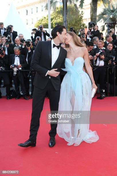 Adrien Brody and Lara Lieto attend the Ismael's Ghosts screening and Opening Gala during the 70th annual Cannes Film Festival at Palais des Festivals...