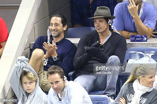 Adrien Brody and Lukas Haas attend the Men's Final on day fourteen of the 2015 US Open at USTA Billie Jean King National Tennis Center on September...