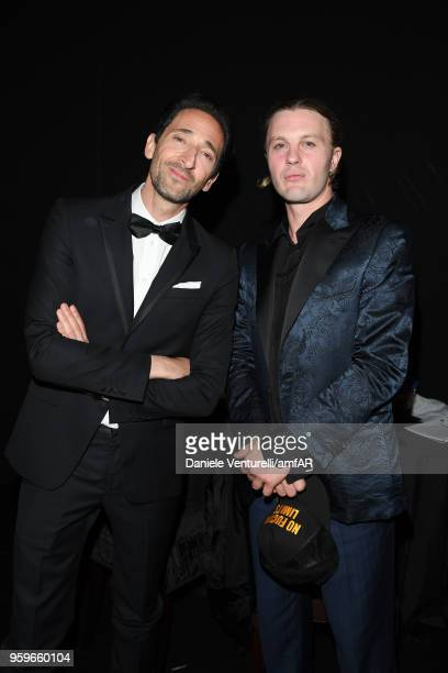 Adrien Brody and Michael Pitt attend the amfAR Gala Cannes 2018 after party at Hotel du CapEdenRoc on May 17 2018 in Cap d'Antibes France