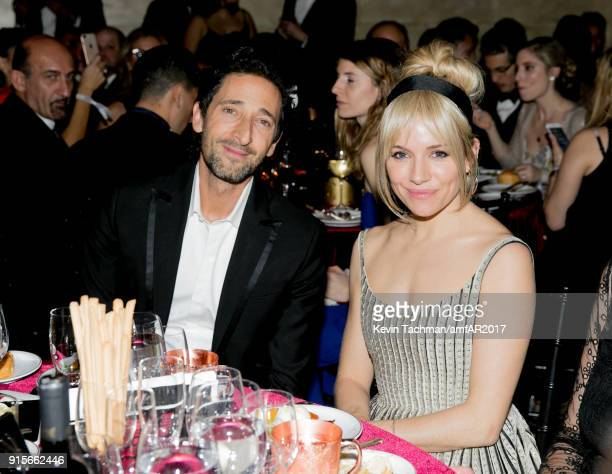 Adrien Brody and Sienna Miller attend the 2018 amfAR Gala New York at Cipriani Wall Street on February 7 2018 in New York City