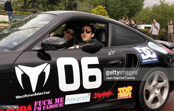 Adrien Brody and teammate at Gumball Rally 3000 in Paris May 5 2004