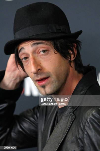 Adrien Brody arrives at the Gucci and RocNation PreGRAMMY brunch held at Soho House on February 12 2011 in West Hollywood California