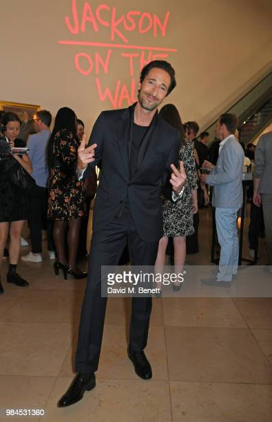 """Adrien Brody attends a private view of the """"Michael Jackson: On The Wall"""" exhibition sponsored by HUGO BOSS at the National Portrait Gallery on June..."""