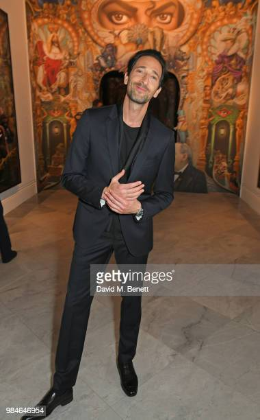 Adrien Brody attends a private view of the Michael Jackson On The Wall exhibition sponsored by HUGO BOSS at the National Portrait Gallery on June 26...