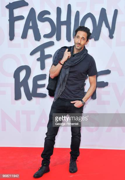 Adrien Brody attends Fashion For Relief Cannes 2018 during the 71st annual Cannes Film Festival at Aeroport Cannes Mandelieu on May 13 2018 in Cannes...