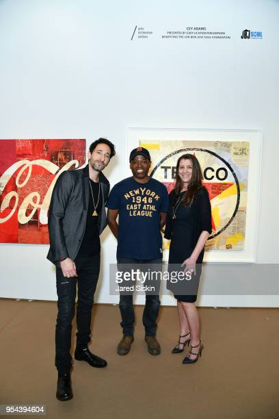 Adrien Brody Cey Adams and Dorothea Hurley attend Art New York on May 3 2018 at Pier 94 in New York City