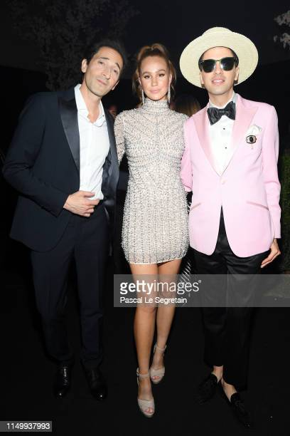 Adrien Brody, Kelsey Evenson, and DJ Cassidy attend the Chopard Love Night dinner on May 17, 2019 in Cannes, France.