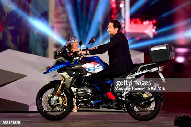 Adrien Brody rides his motorbike on stage during the Life Ball 2018 show at City Hall on June 2 2018 in Vienna Austria The Life Ball an annual...