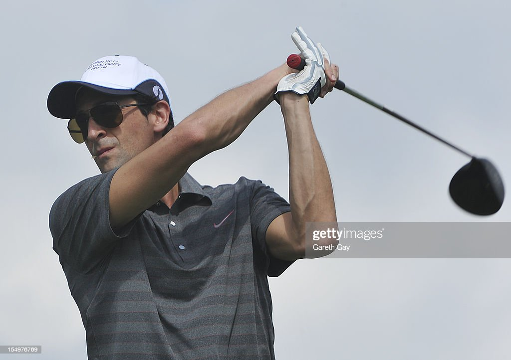 Adrien Brody tees off the second hole on Day 4 of the Mission Hills World Celebrity Pro-Am at Mission Hills Haikou resort on October 21, 2012 in Haikou, China.