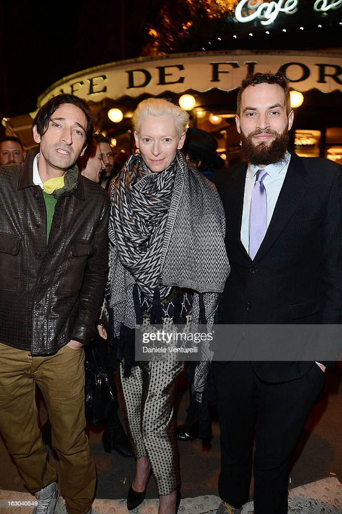 Adrien Brody, Tilda Swinton and Sandro Kopp attend the Bulgari And Purple Magazine Party at Cafe de Flore on March 3, 2013 in Paris, France.