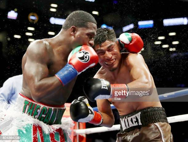 Adrien Broner and Mikey Garcia exchange punches during their Junior Welterwight bout on July 29, 2017 at the Barclays Center in the Brooklyn borough...