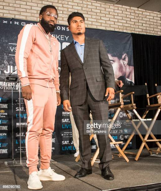 Adrien Broner and Mikey Garcia pose during the Adrien Broner vs Mikey Garcia Welterweight press conference at the Dream Hotel June 19 2017 in New...