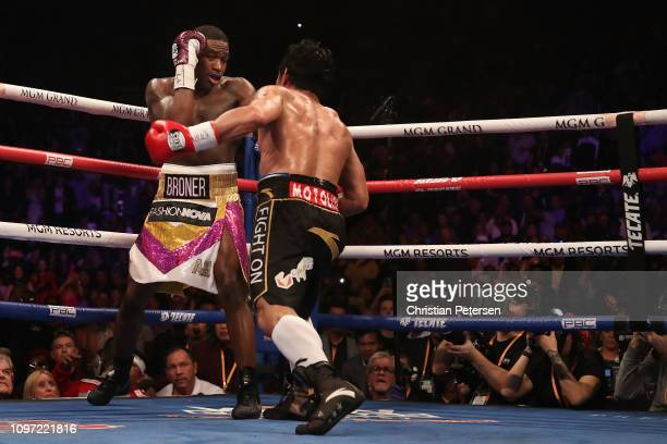 Adrien Broner backs into the corner as Manny Pacquiao throws a left during the WBA welterweight championship at MGM Grand Garden Arena on January 19...