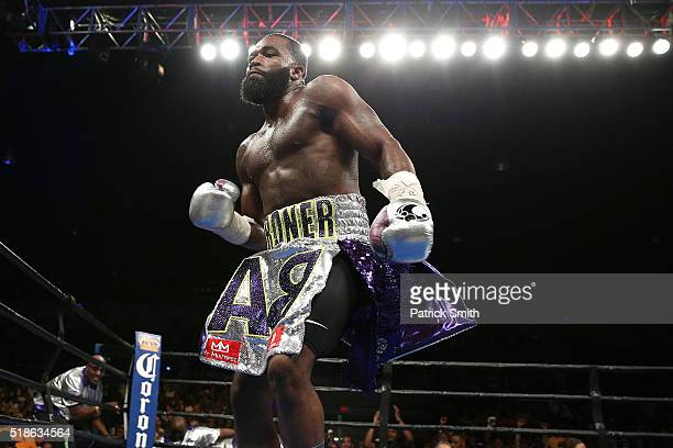 Adrien Broner celebrates after defeating Ashley Theophane by TKO in ninth round in their super lightweight championship bout at the DC Armory on...