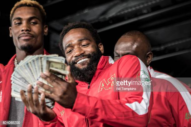 Adrien Broner flashes $100 bills during the Adrien Broner vs Mikey Garcia Final Press Conference at the Dream Hotel July 27 2017 in New York City