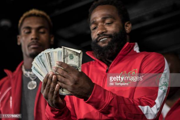 Adrien Broner flashing money during the Adrien Broner vs Mikey Garcia Final Press Conference at the Dream Hotel July 27, 2017 in New York City.
