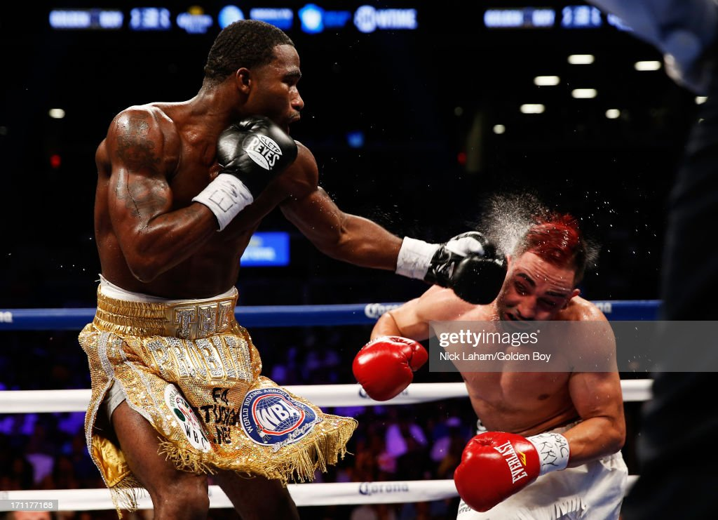 Adrien Broner (L) lands a punch on Paulie Malignaggi during their WBA Welterweight Title bout at Barclays Center on June 22, 2013 in the Brooklyn borough of New York City.