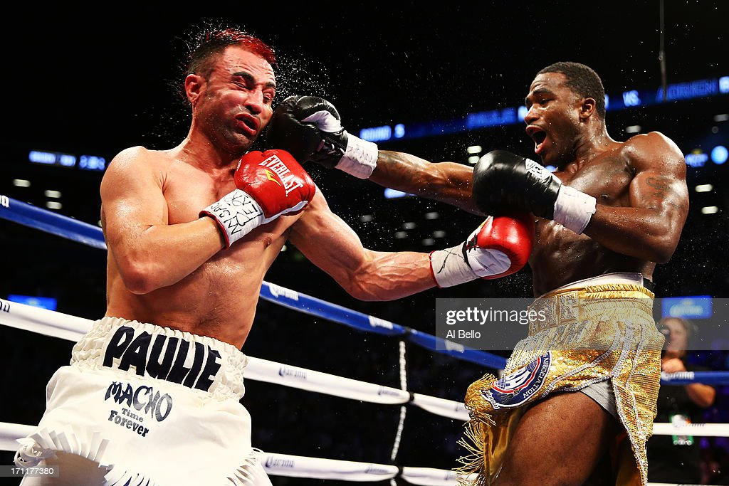 Adrien Broner lands a punch on Paulie Malignaggi during their WBA Welterweight Title bout at Barclays Center on June 22, 2013 in the Brooklyn borough of New York City.