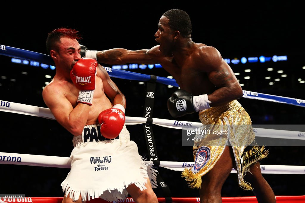 Adrien Broner (R) lands a punch on Paulie Malignaggi during their WBA Welterweight Title bout at Barclays Center on June 22, 2013 in the Brooklyn borough of New York City.