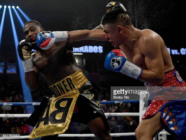 Adrien Broner left hits Adrian Granados while dodging a right hook during their fight on February 18 2017 in Cincinnati Ohio