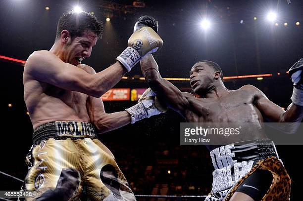 Adrien Broner punches John Molina Jr. During a Premier Boxing Champions bout in the MGM Grand Garden Arena on March 7, 2015 in Las Vegas, Nevada.