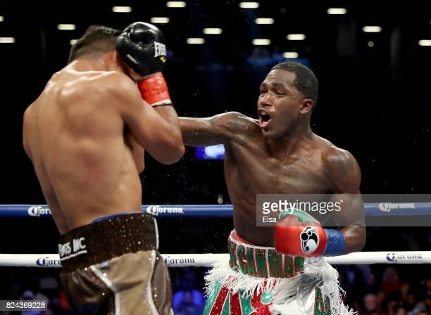 Adrien Broner punches Mikey Garcia during their Junior Welterwight bout on July 29 2017 at the Barclays Center in the Brooklyn borough of New York...