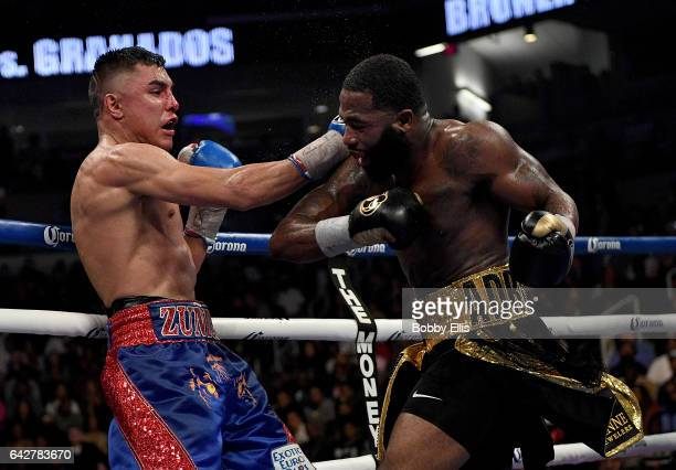 Adrien Broner right dodges a punch from Adrian Granados left during their fight at the Cintas Center on February 18 2017 in Cincinnati Ohio