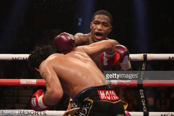 Adrien Broner throws a left at Manny Pacquiao during the WBA welterweight championship at MGM Grand Garden Arena on January 19 2019 in Las Vegas...