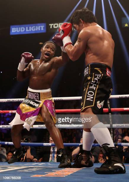 Adrien Broner throws a left on Manny Pacquiao during the WBA welterweight championship at MGM Grand Garden Arena on January 19 2019 in Las Vegas...