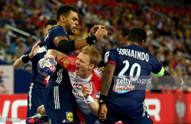Adrien Dipanda of France challenges Anders Zachariassen of Denmark during the Men's Handball European Championship 3rd place match between France and...