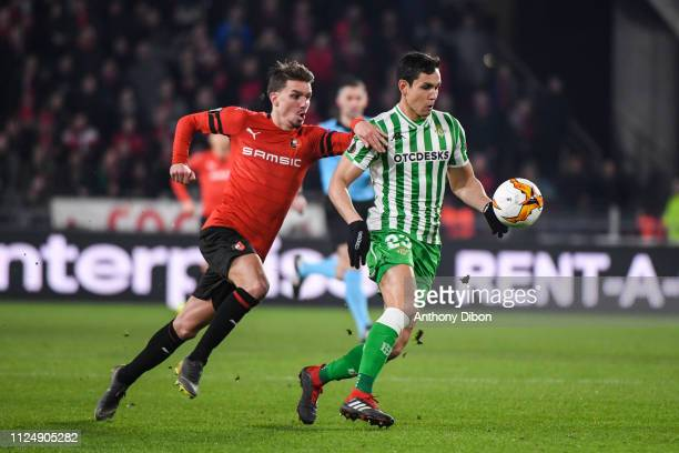 Adrien Hunou of Rennes and Aissa Mandi of Real Betis during the UEFA Europa League Round of 32 First Leg match between Rennes and Real Betis at...