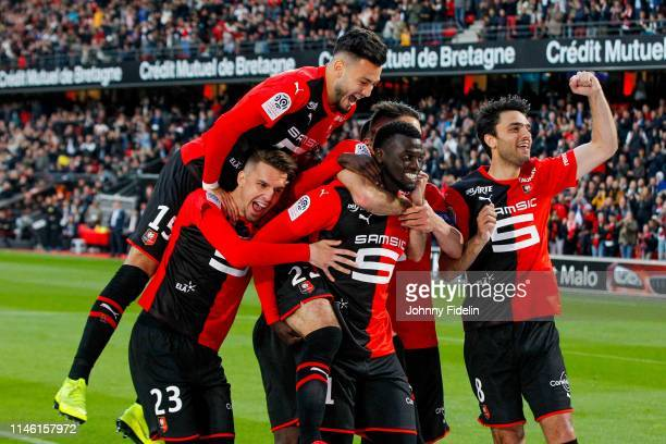 Adrien Hunou Rami Bensebaini Clement Grenier Mbaye Niang of Rennes celebrate his goal during the Ligue 1 match between Stade Rennais football club...