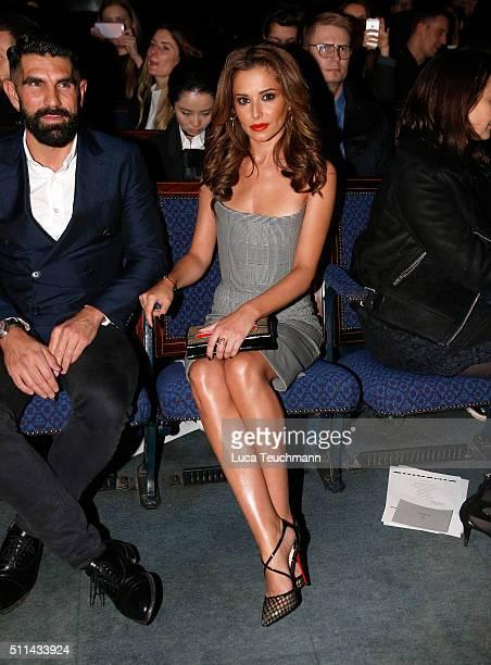 Adrien Koskas and Cheryl FernandezVersini attend the Gareth Pugh show at Fashion Scout during London Fashion Week Autumn/Winter 2016/17 at...