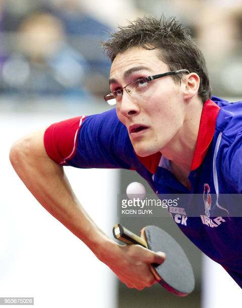 Adrien Mattenet of France plays Jun Mizutani of Japan during their fourth round World Table Tennis Championship match in Rotterdam on May 12 2011 AFP...